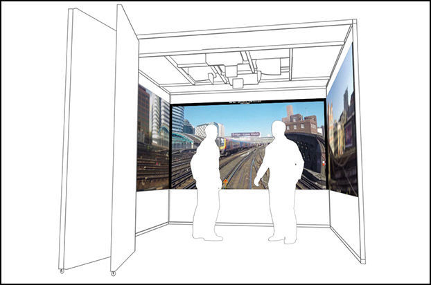 2 men standing inside the Mission Room Arena display watching immersive rail footage