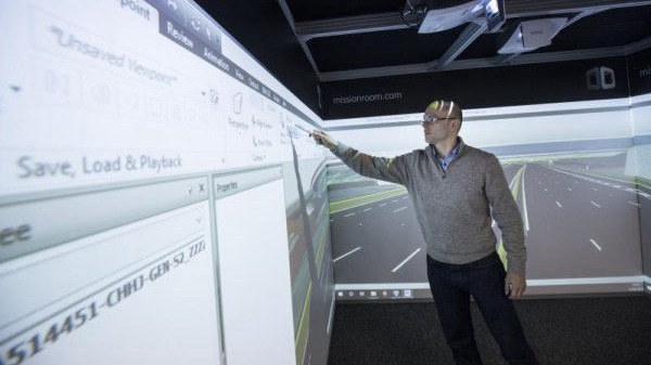 A man using the touchscreen feature in a Cube system